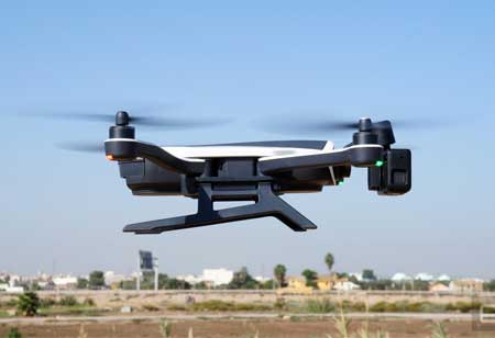 Unlimited Flying Time for Drones with Wireless Charging Hotspots